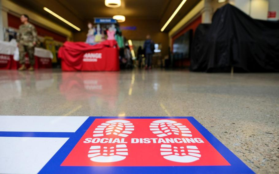 A social distancing decal is posted outside the exchange at Camp Humphreys, South Korea, March 27, 2020.