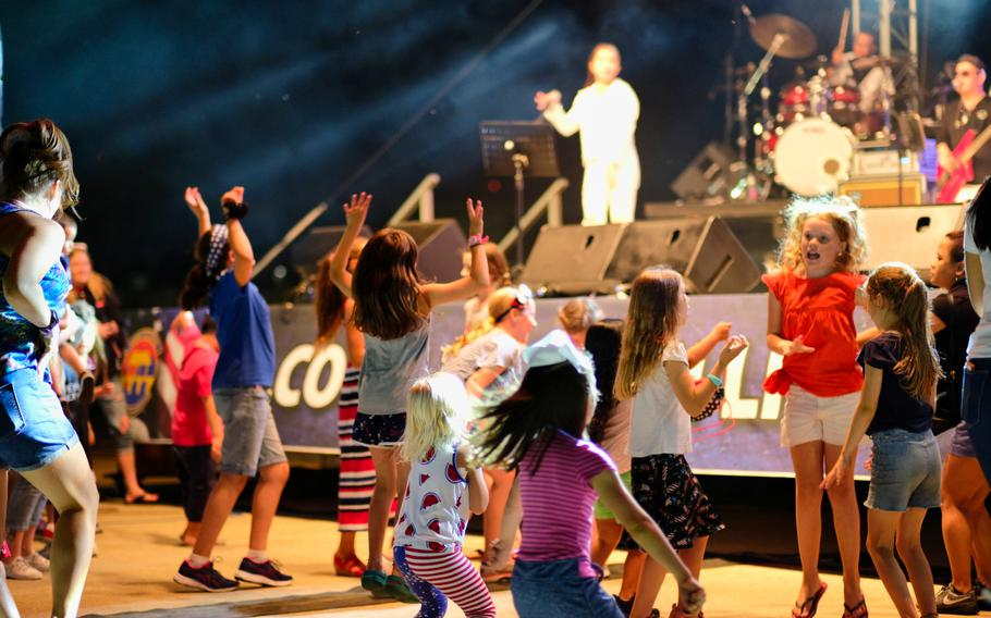 Children dance during a live musical performance by local band Street Beat during Liberty Fest 2020 on Osan Air Base, South Korea, Saturday, July 4, 2020.