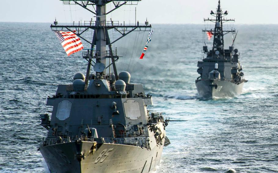 The guided-missile destroyer USS McCampbell, left, and the JMSDF destroyer Takanami sail together in the Pacific Ocean on March 9, 2014.
