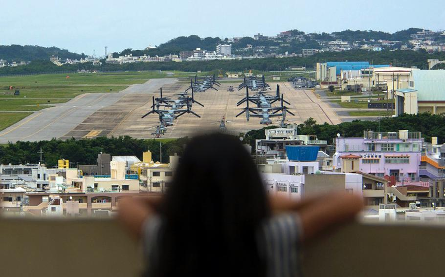 A child looks out at aircraft at Marine Corps Air Station Futenma, Okinawa, April 19, 2019.