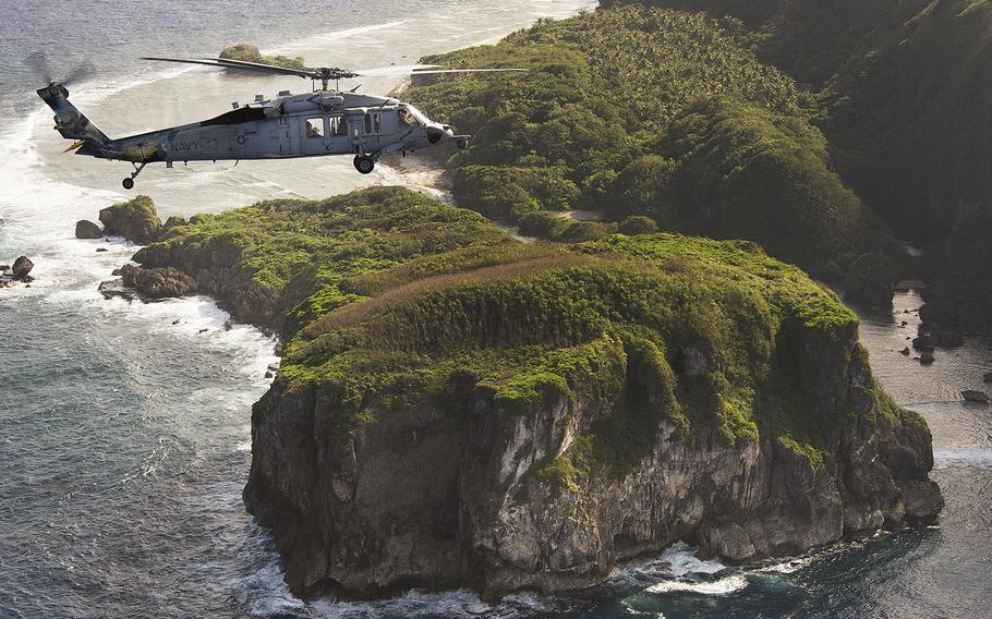 An MH-60S Seahawk assigned to Helicopter Sea Combat Squadron 25 flies off off the coast of Guam in December 2015.