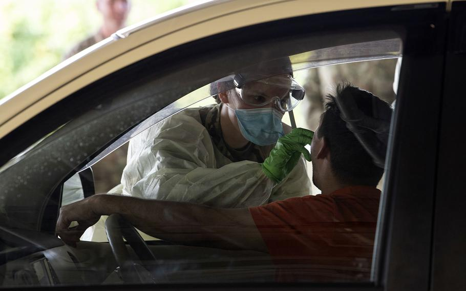 Airmen from the 18th Medical Group conduct coronavirus testing at Kadena Air Base, Okinawa, March 20, 2020.
