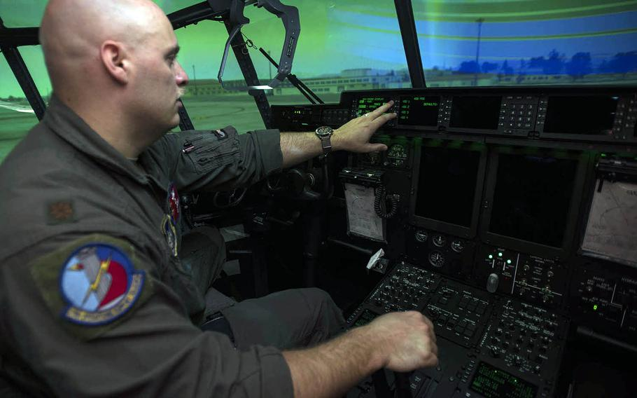 Maj. Chris Wolff, assistant director of operations for the 374th Airlift Wing's Operations Support Squadron, gives a tour inside the new C-130J Super Hercules flight simulator at Yokota Air Base, Japan, Monday, July 27, 2020.