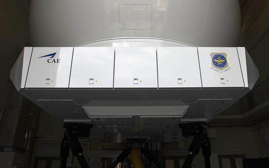 During sessions inside this C-130J Super Hercules flight simulator at Yokota Air Base in Japan, a curved mirror reflects five video feeds through the front windows while a hi-fi sound system mimics engine noise and electronic legs tilt the cabin to give those inside the sensation of motion.