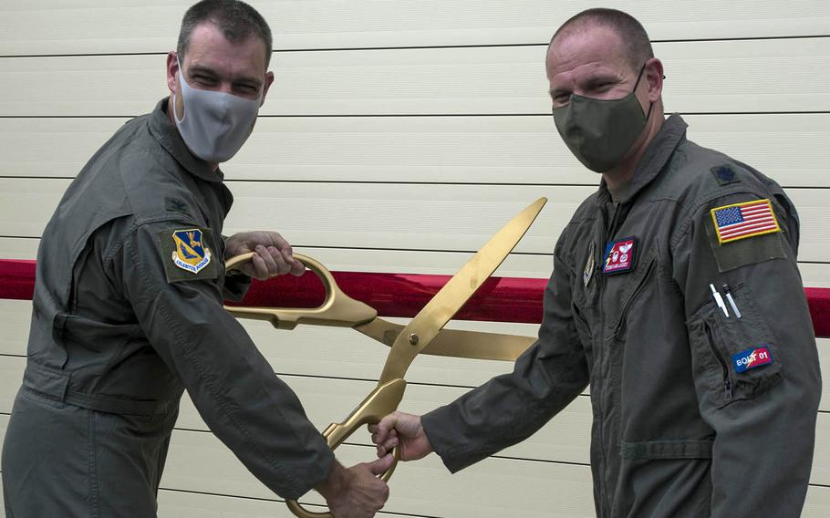 Col. Andrew Campbell, commander of the 374th Airlift Wing, and Lt. Col. Donavan Laskey, commander of the 374th Operations Support Squadron, officially open a new C-130J Super Hercules flight similar at Yokota Air Base, Japan, Monday July 27, 2020.
