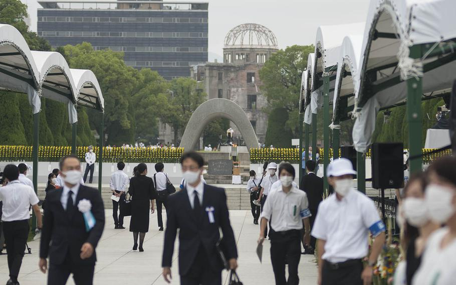 People gather at Hiroshima Peace Memorial Park, Thursday, Aug. 6, 2020, to mark the atomic bombing's 75th anniversary.