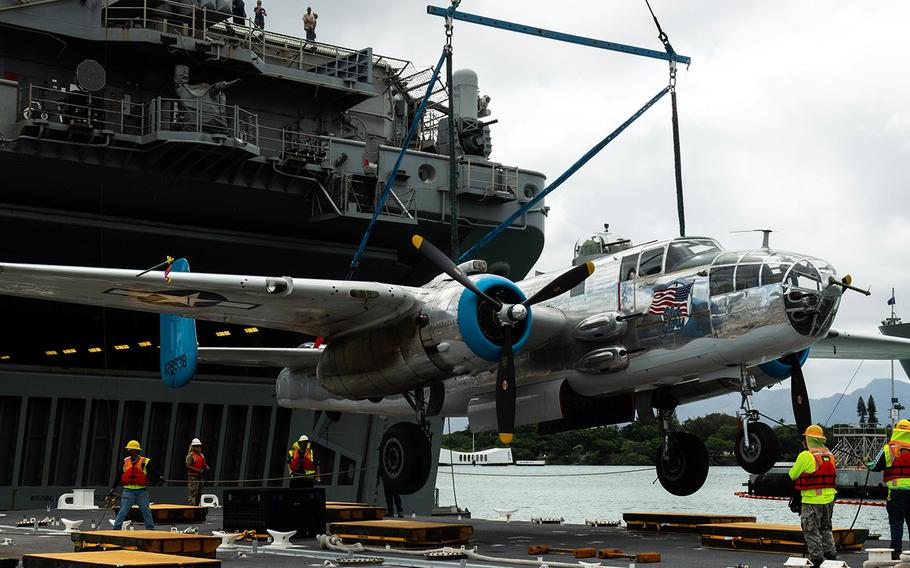 A B-25 Mitchell bomber, the same kind of aircraft flown in the historic Doolittle Raid in April 1942, is unloaded from the USS Essex at Joint Base Pearl Harbor-Hickam, Hawaii, Aug. 11, 2020.