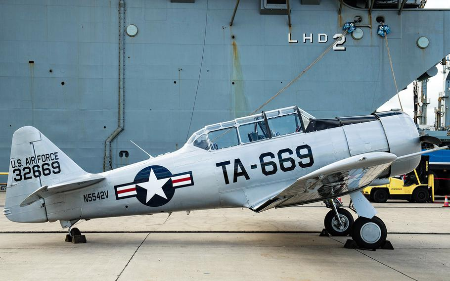 A North American T-6 Texan stands on a dock at Joint Base Pearl Harbor-Hickam in Hawaii after being offloaded from the USS Essex on Aug. 11, 2020.