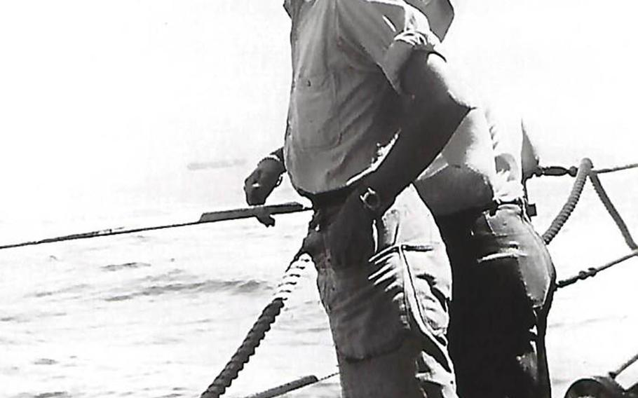 Donald Fosburg stands on a ship's deck in this undated photo taken during World War II.