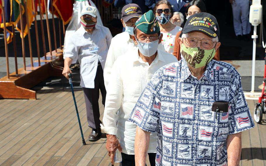 World War II veterans walk to the fantail of the battleship Missouri on Sept. 2, 2020, for a commemoration of the 75th anniversary of the end of the war.