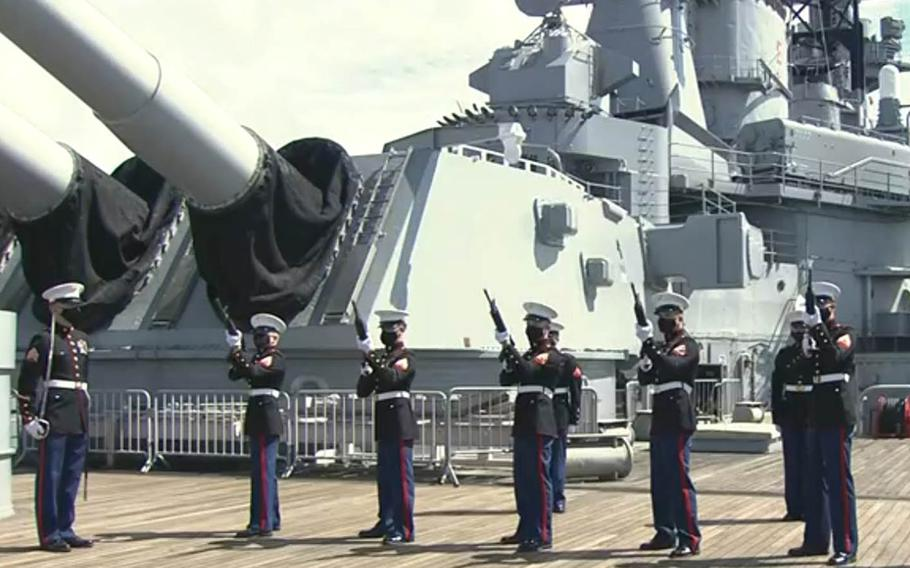 A Marine Corps honor guard fires a rifle salute during a commemoration for the end of World War II at the Battleship Missouri Memorial, Hawaii, Sept. 2, 2020.