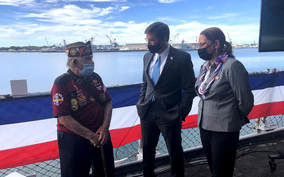 Wendell Newman, a 92-year-old Army veteran of World War II, speaks with Secretary of Defense Mark Esper and his wife, Leah, on the Battleship Missouri Memorial in Hawaii, Sept. 2, 2020.