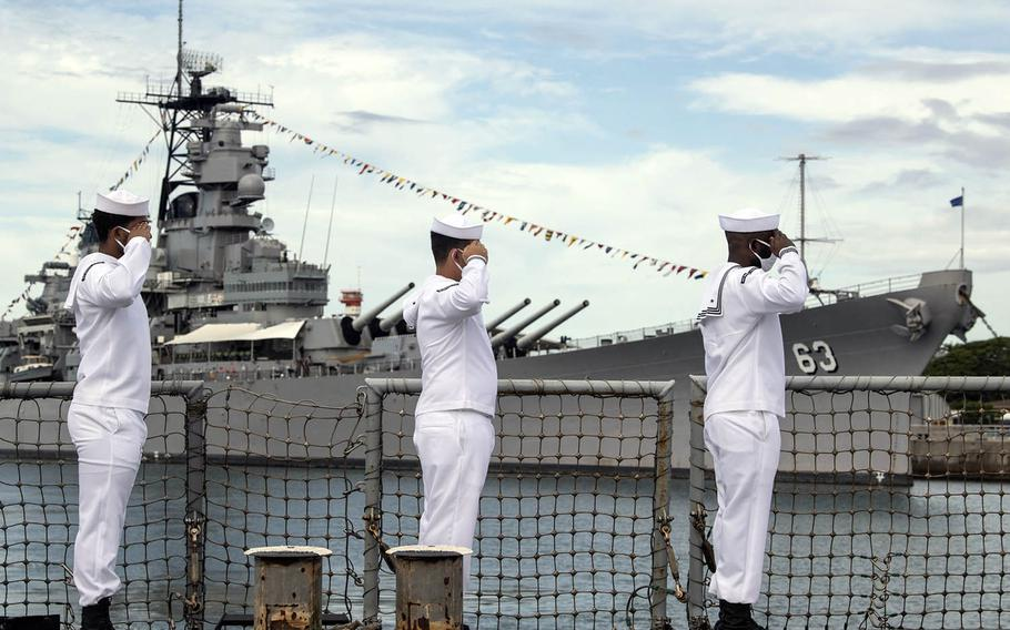 Sailors aboard the guided-missile destroyer USS Michael Murphy render honors to the Battleship Missouri Memorial in Pearl Harbor, Hawaii, during a ceremony Sept. 2, 2020, for the 75th commemoration of the end of World War II.