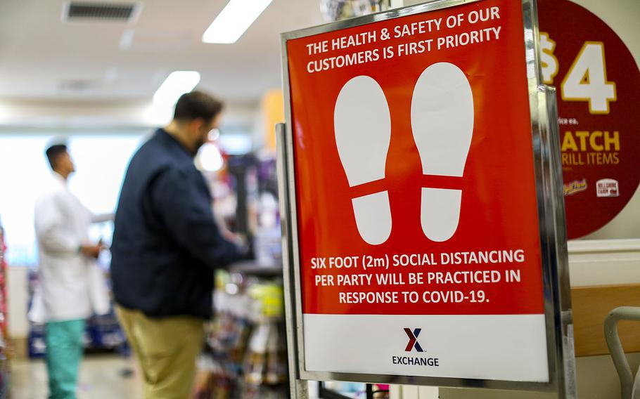 A sign outside an exchange store reminds customers to practice social distancing at Camp Foster, Okinawa, April 3, 2020.
