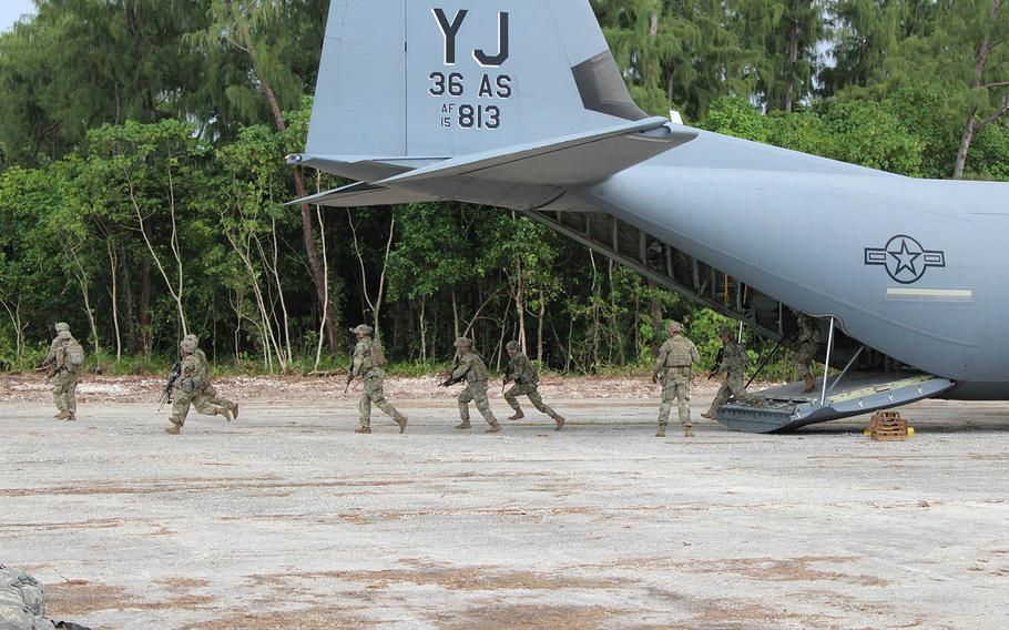 An Air Force C-130 Hercules delivers U.S. troops onto the newly renovated Angaur Airfield for training in the Republic of Palau, Sept. 6, 2020.