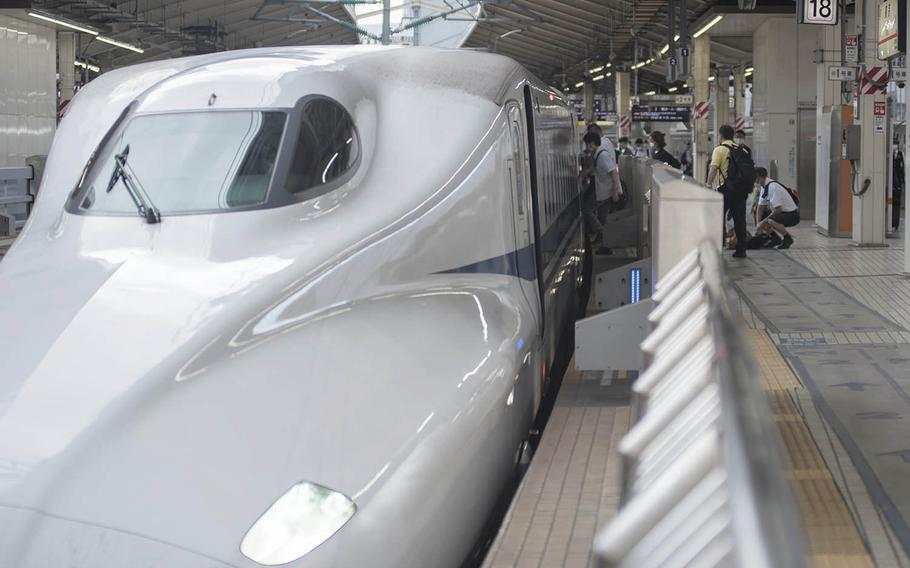 Passengers board a shinkansen, also known as a high-speed bullet train, at Tokyo Station, Sept. 3, 2020.