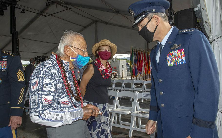 Air Force Gen. Ken Wilsbach, commander of Pacific Air Forces, speaks with World War II veteran Arthur Shak during a ceremony commemorating the 75th anniversary of the end of the war aboard the Battleship Missouri Memorial at Pearl Harbor, Hawaii, Sept. 2, 2020.
