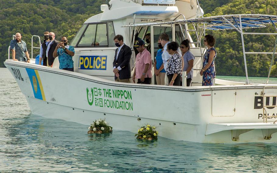 Secretary of Defense Mark Esper and Republic of Palau President Tommy Remengesau lay wreaths offshore of Koror, Palau, Aug. 28, 2020.