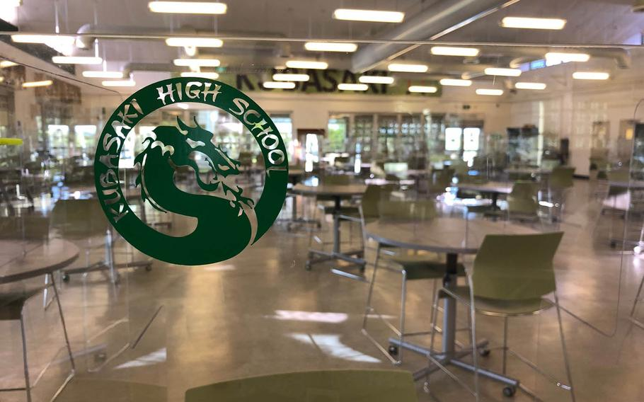 Cafeteria tables equipped with plastic dividers, embossed with the school logo, are seen at Kubasaki High School on Camp Foster, Okinawa, Monday, Sept. 21, 2020.