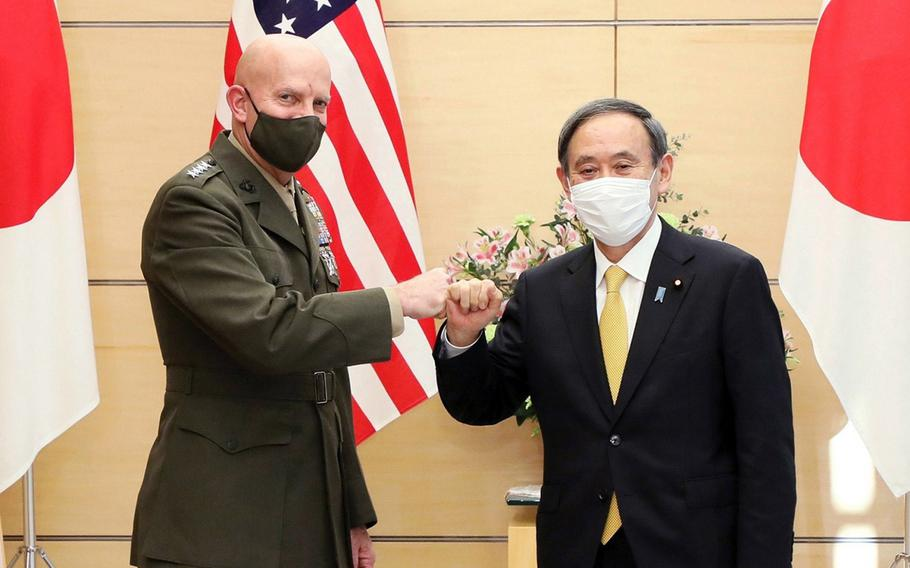 The Marine Corps commandant, Gen. David H. Berger, poses with Japanese Prime Minister Yoshihide Suga in Tokyo, Wednesday, Nov. 18, 2020.