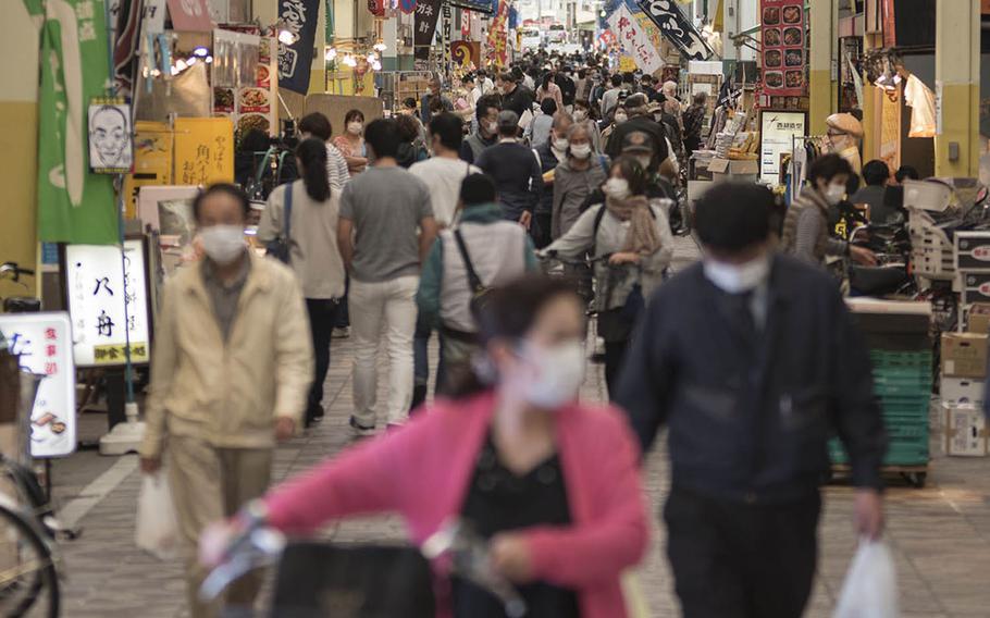 People wear masks while visiting the Yokohamabashi shopping district in Yokohama, Japan, Nov. 20, 2020.