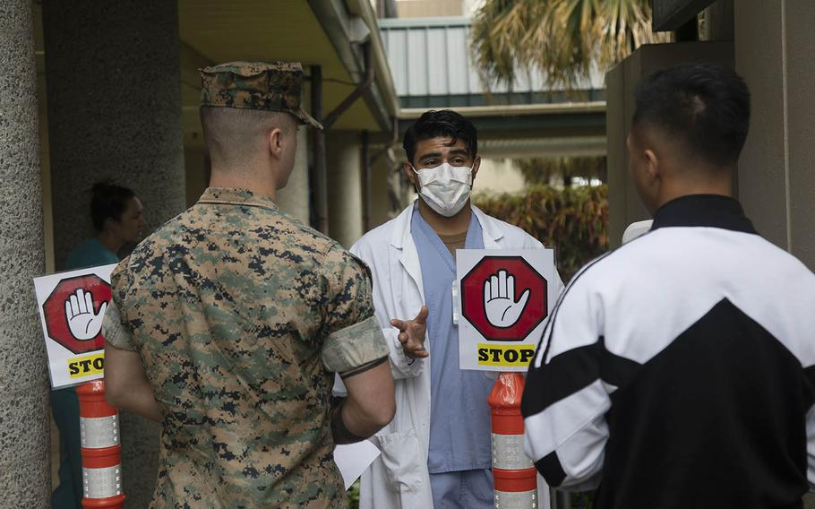 Medical personnel at Marine Corps Base Hawaii take preventative measures due to the coronavirus pandemic, March 23, 2020.