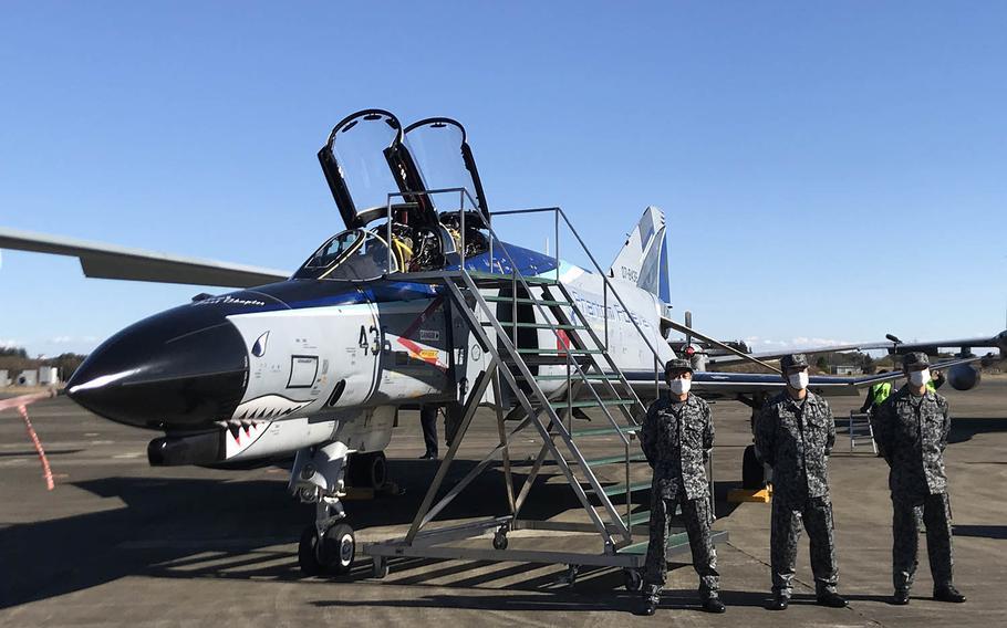 "One of Japan's iconic F-4EJ ""Samurai"" Phantom II fighter jets awaits a photo op with Japanese Prime Minister Yoshihide Suga at Iruma Air Base, Japan, Saturday, Nov. 28, 2020."
