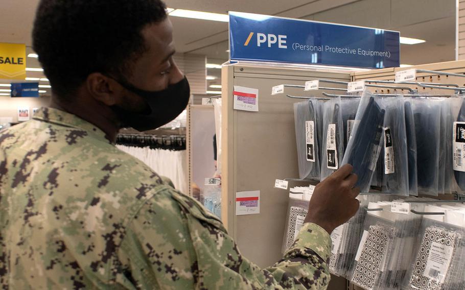 A sailor checks out masks for sale inside the Fleet Store at Yokosuka Naval Base, Japan, Aug. 6, 2020.