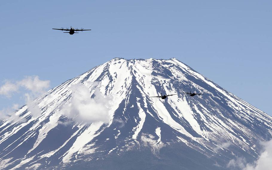Three C-130J Super Hercules assigned to the 36th Airlift Squadron at Yokota Air Base, Japan, fly near Mount Fuji, May 11, 2020.