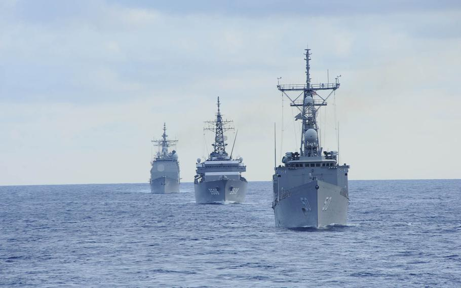 The guided-missile frigate USS Taylor leads Navy and Japan Maritime Self-Defense Force ships participating in a passing exercise in 2011.