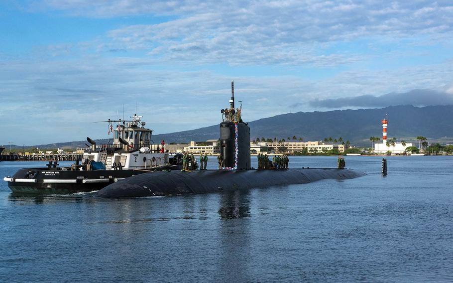 The Los Angeles-class fast-attack submarine USS Topeka arrives in Pearl Harbor, Hawaii, after completing a change of homeport from Guam, Dec. 15, 2020.