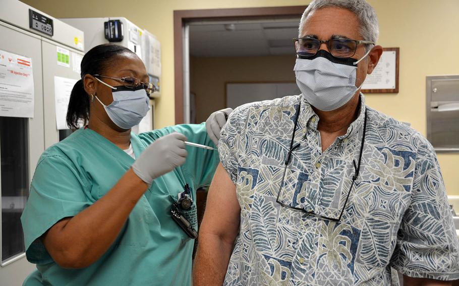 Dr. Scott Belnap, a physician at Tripler Army Medical Center in Honolulu, Hawaii, receives the COVID-19 vaccine, Wednesday, Dec. 16, 2020.