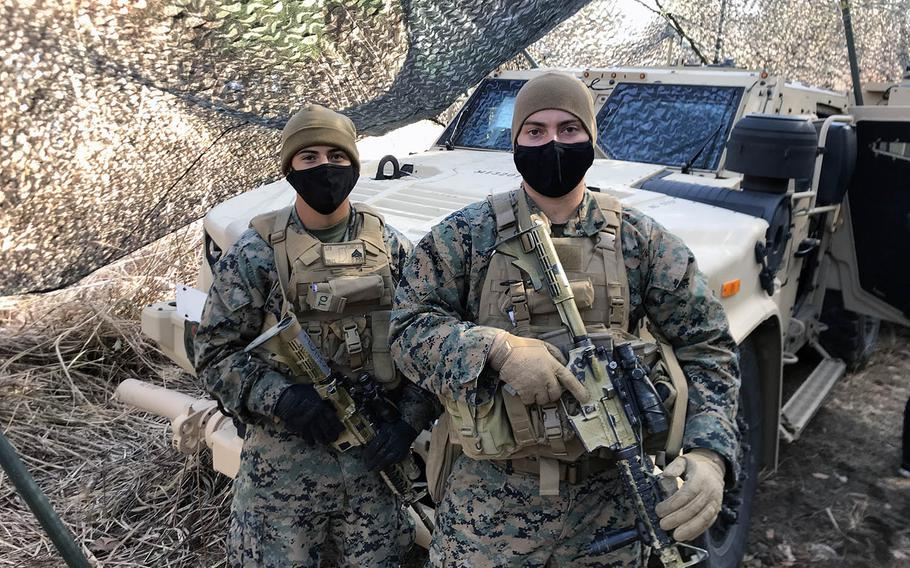 From left, Marine Cpl. Juan Flores, 20, of Ft. Wayne, Ind., and Cpl. Devin Gates, 26, of Panama City, Fla. with a Joint Light Tactical Vehicle during training in Gunma prefecture, Japan, Dec. 15, 2020.