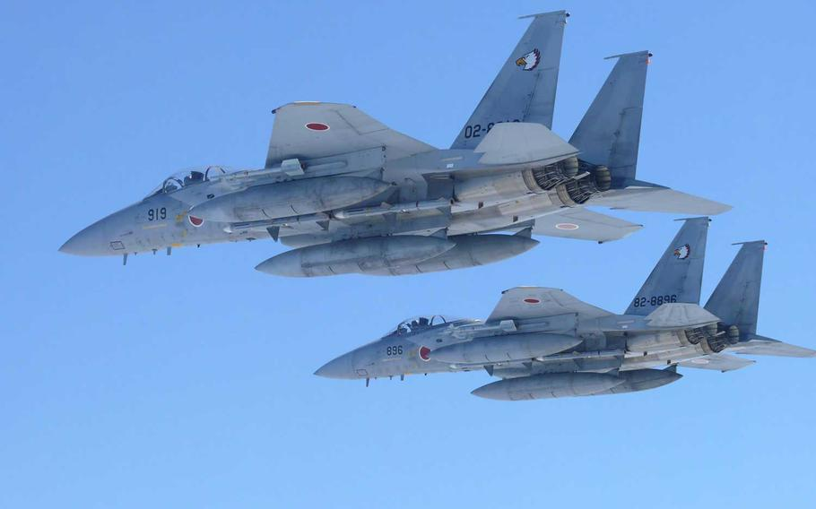 Money to upgrade F-15 fighters of the Japan Air Self-Defense Force, like those seen here, was not included in a defense budget for the coming fiscal year approved Dec. 21, 2020, by Japan's Cabinet.