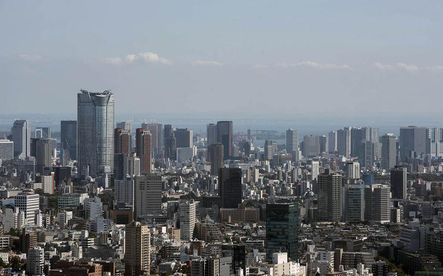 Tokyo, a city of 13.5 million, within two days during the week of Dec. 13, 2020, hit its highest and second highest daily totals for new coronavirus infections.