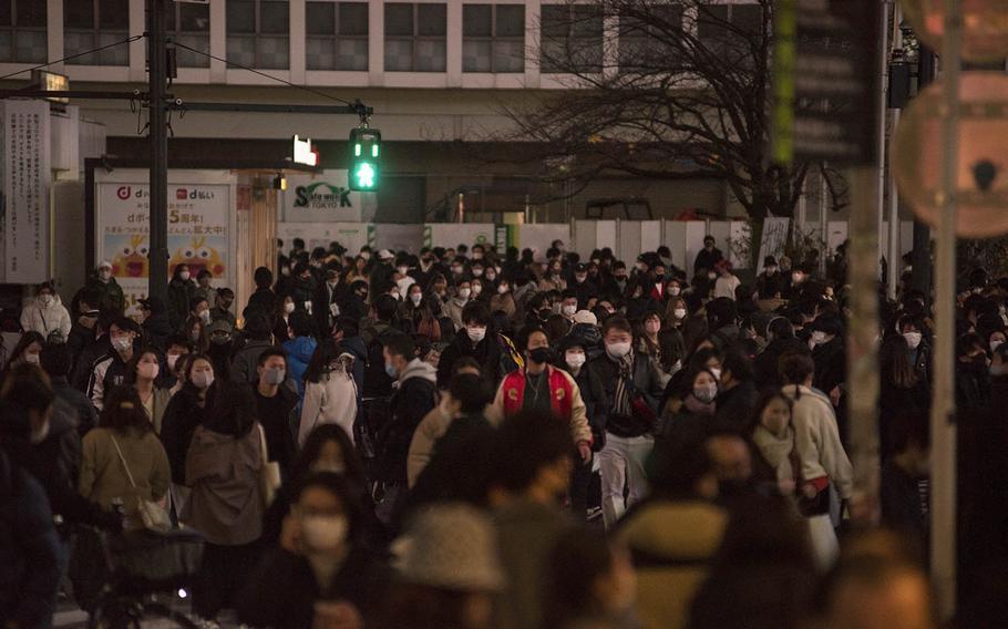 Hundreds scramble across the Shibuya crossing in Tokyo on Sunday, Dec. 20, 2020.