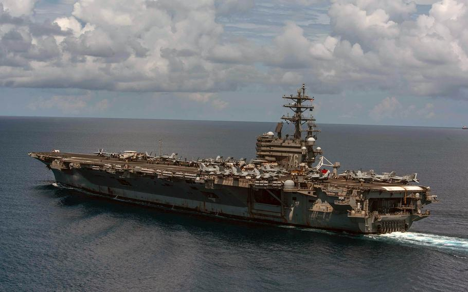 Coronavirus forced some of its crew to quarantine aboard the aircraft carrier USS Ronald Reagan,  shown here in July 2019, at its homeport, Yokosuka Naval Base, Japan, for the December 2020 holidays.