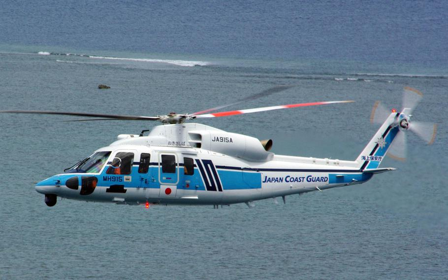 A Japan Coast Guard MH-915 helicopter, like this one in an undated photo, took part in a two-day search for a missing U.S. Navy civilian employee starting Dec. 15, 2020.