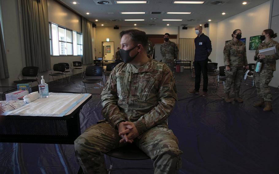 Air Force Col. Jay Veeder, 18th Medical Group commander, waits for the Moderna coronavirus vaccine at Kadena Air Base, Okinawa, Japan, on Monday, Dec. 28, 2020.