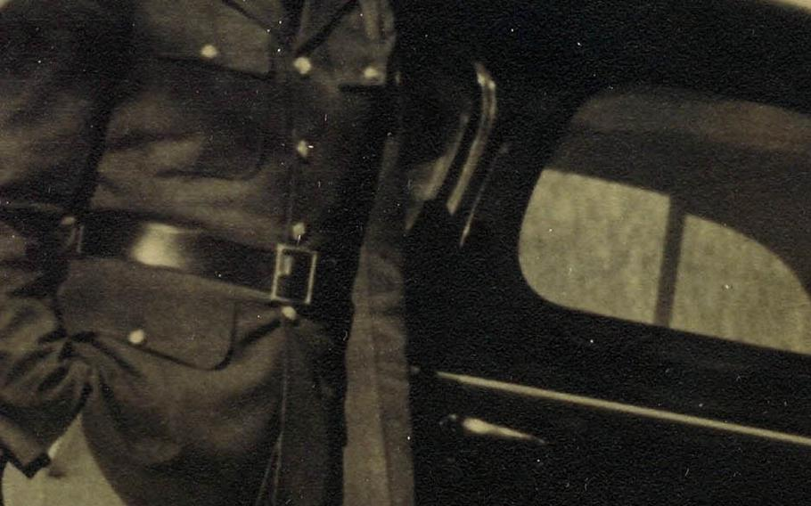 Daniel Crowley poses in his uniform in this undated photo taken before he shipped out for the Philippines in 1940.