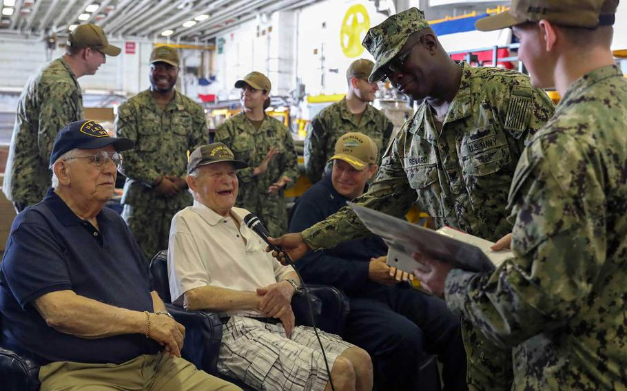 Dan Crowley talks with sailors aboard the USS Bataan on April 26, 2019, at the amphibious assault ship's homeport of Naval Station Norfolk, Va.