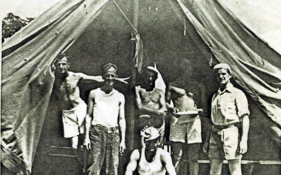 Dan Crowley, far right, stands by a tent in this undated photo taken with other service members in the Philippines during World War II.