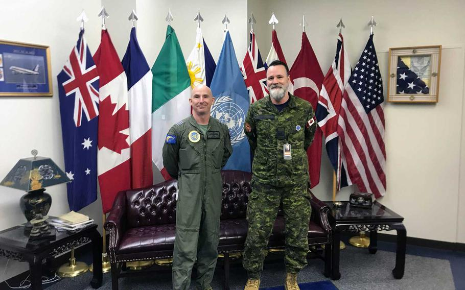 United Nations Command's Rear commander Royal Australian Air Force Col. Adam Williams, left, and deputy commander, Royal Canadian Air Force Maj. Leon Hachey at their office on Yokota Air Base, Japan, Nov. 24, 2020.