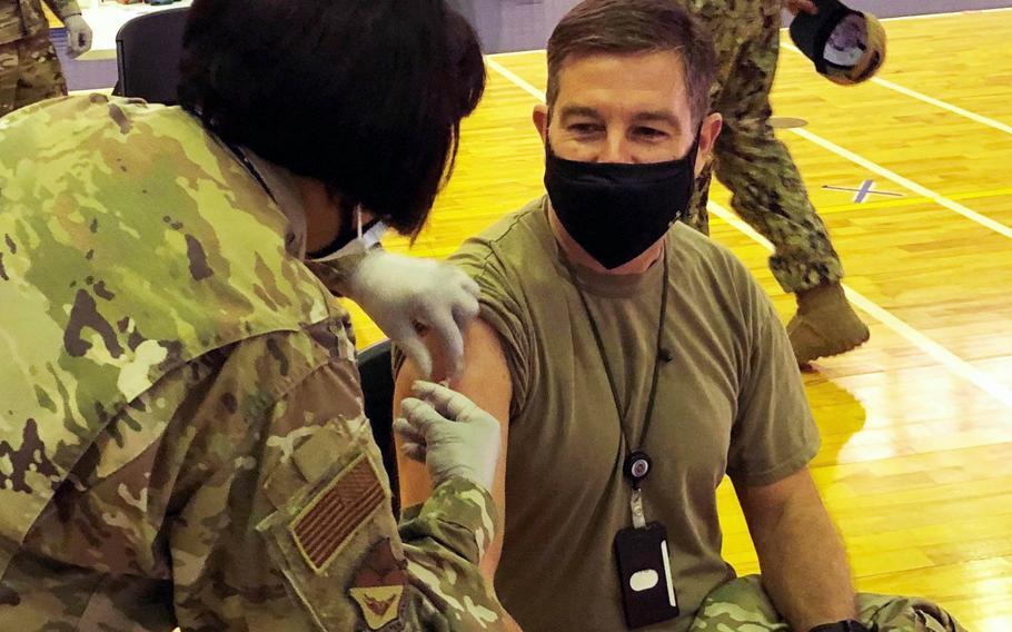 Chief Master Sgt. Rick Winegardner Jr., senior enlisted leader for U.S. Forces Japan, receives the Moderna coronavirus vaccine at Yokota Air Base, Japan, Wednesday, Jan. 13, 2021.