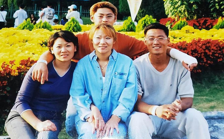 Hyon Chu DuCharme, center, poses with her siblings in this undated family photo. From left: Yae-Wong Hwang, Hyeon-Mi Hwang and Sae-Min Hwang.