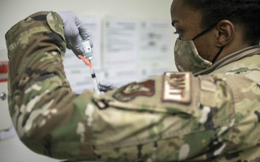 Tech. Sgt. Alexisa Humphre of the 8th Medical Group prepares to inject a dose of the Moderna coronavirus vaccine at Kunsan Air Base, South Korea, Dec. 29, 2020.