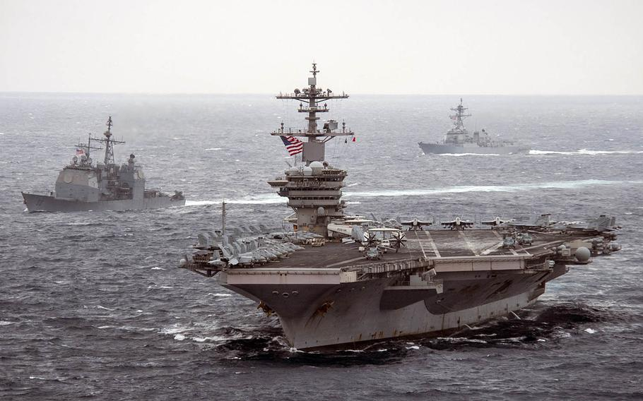 The aircraft carrier USS Theodore Roosevelt, front, the guided-missile cruiser USS Bunker Hill, left, and the guided-missile destroyer USS John Finn sail together somewhere in the Pacific Ocean, Jan. 15, 2021.