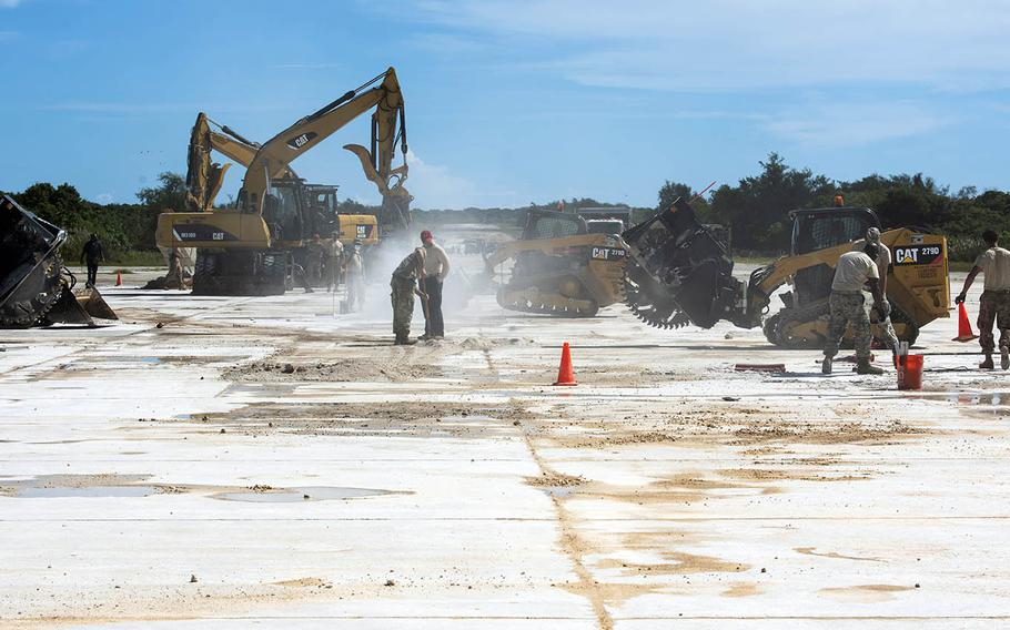 Airmen conduct rapid airfield damage repair on the flight line of Northwest Field at Andersen Air Force Base, Guam, Oct. 15, 2019.