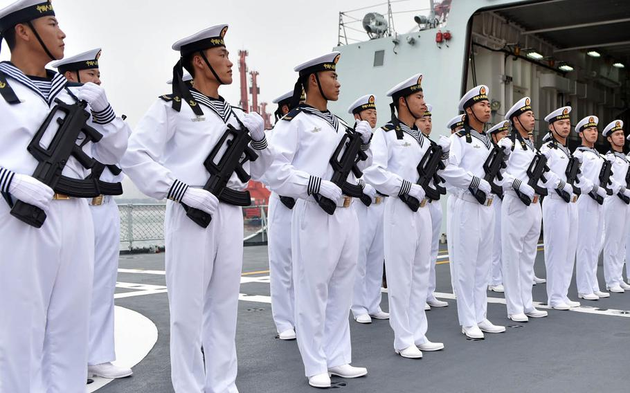 Members of the Submarine Academy in Qingdao, China, stand at attention during a visit by the United States' chief of naval operations, July 20, 2016.