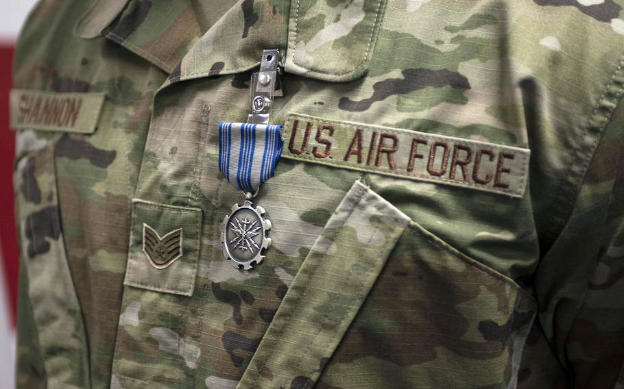 Staff Sgt. Seth Shannon, kennel master for the 374th Security Forces Squadron at Yokota Air Base in Tokyo, received the Air Force Achievement Medal on Thursday, Jan. 28, 2021, for working around coronavirus restrictions to bring much-needed military working dogs to Japan.